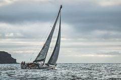 Close-up lone yacht sailing in the sea. Ireland. stock photos