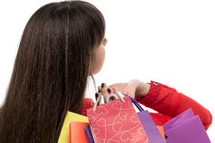 Close-up of long-haired young woman head with colourful shopping Stock Photography