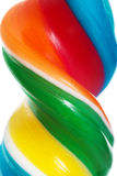 Close up on longitudinal and colorful lollipop. Royalty Free Stock Photo