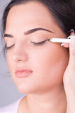 Close up look of applying cosmetic pencil Stock Photo