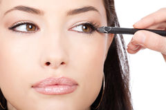 Close up look of applying cosmetic pencil Royalty Free Stock Images