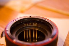 A close up look of a lens adapter with autofocus contacts. Photo equipment details Royalty Free Stock Photo