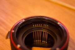 A close up look of a lens adapter with autofocus contacts. Stock Images
