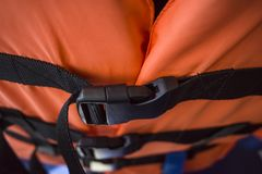 A close-up look of life vest jacket. A close-up look of locked orange colour life vest jacket stock photography