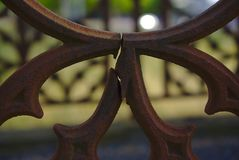 Broken part of grave fence stock photography