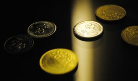 A close up look of scatter coins stock images