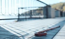 Close up look on walking cane lying on sidewalk Royalty Free Stock Photo
