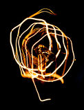 Close up looping carbon filament of vintage Edison light bulb. Royalty Free Stock Images