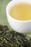 Close-up of loose green tea and cup Royalty Free Stock Photo