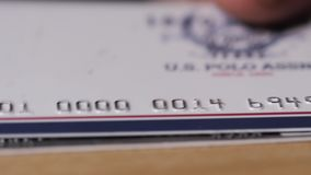 Close up of lot bank cards. Credit card concept with window light on desk stock video