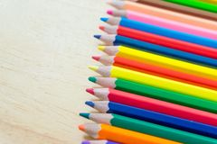 Close up of a lot of color pencil on wood background stock photos