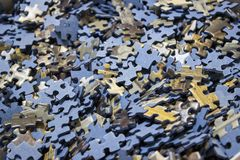 Close-up of a sea of jigsaw puzzles inside a box royalty free stock photo