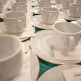 Close up a lot of white cups on the table royalty free stock images