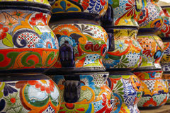 Colorful Mexican Talavera pots. Close up of lots of colorful Mexican Talavera pots for sale at garden store Stock Images