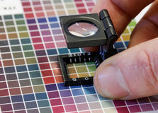 Close-up of a loupe on a colorful test print Stock Image