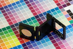 Close-up of a loupe on a colorful test print Stock Photos