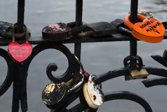 Close Up of Love Locks. Close up of a  black metal fence on a bridge over the Iset River in Yekaterinburg Russia that is adorned with multiple padlocks. The Royalty Free Stock Photography