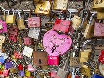 Close-up of love padlocks on the fence between the footpath and the railway lines of Hohenzollern Bridge in Cologne, Germany stock image