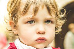 Close-up of a lovely child with beautiful eyes stock photography