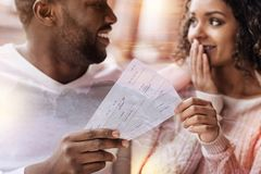 Close up of lovely couple with flight tickets stock photography