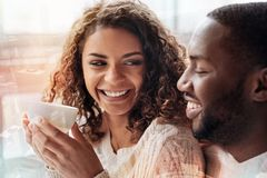 Close up of lovely couple looking at each other. True emotions. Close up of positive lovely couple spending time together while looking at each other and royalty free stock image