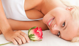 Close up of a lovely woman with a flower Royalty Free Stock Image