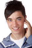 Close-up of lovely young male listening mp3 music Royalty Free Stock Photo