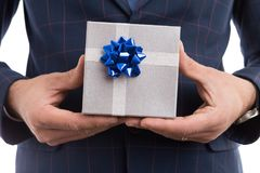 Close-up of lover hands holding gift royalty free stock image