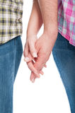 Close-up of lovers holding hands together. As attachement concept on white background Royalty Free Stock Photos