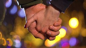 Close-up of a loving couple holding hands in winter stock video