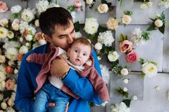 Close-up of a loving father kissing his baby daughter. The man became a father and cherishes his child. A gentle kiss. Close-up of a loving father kissing his Royalty Free Stock Images