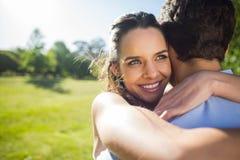 Close-up of a loving woman embracing man at park Stock Photos
