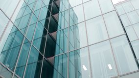Close-up low angle shot of modern glass facade office building in Paris Stock Photography