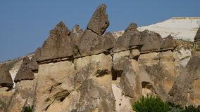 Erect cone-shaped rock formations in a group