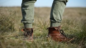 Close-up low angle Unrecognizable man in stylish vintage shoes walks into the frame stands and goes. Travel concept.  stock video footage
