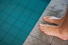 Close up low section of barefeet by pool. Close up low section of barefeet by the pool at leisure center Royalty Free Stock Photos