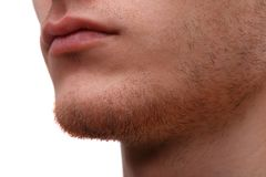 Close-up of the lower part of a man`s face. Isolated over white background Stock Photo