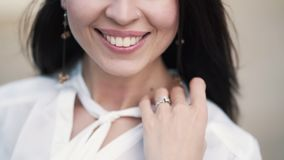 Close up lower part of woman face, beautiful smile, slow motion. Young attractive woman with perfect skin stock footage