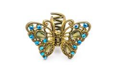 Close up luxo velho ao grampo de cabelo dourado decorado da borboleta, isolado Fotografia de Stock
