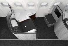 Close-up of luxurious business class seat with frosted acrylic partition. Royalty Free Stock Photos