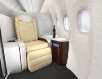 Close-up of luxurious business class seat with metallic silver partition. Royalty Free Stock Images
