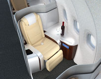 Close-up of luxurious business class seat with metallic silver partition. Stock Photos