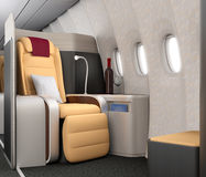 Close-up of luxurious business class seat with metallic silver partition. Royalty Free Stock Photography
