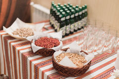 Close-up of luxurious rural-style catering table in restaurant ready for wedding celebration. Focus on salty peanuts Stock Images