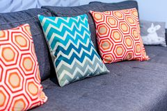 Luxury cozy couch close up with decorative pillows in geometric Royalty Free Stock Photography