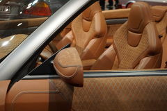 Close up of a luxury custom made fine leather car Stock Images