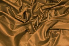 Close up of the luxury gold cloth or liquid wave or wavy folds o Stock Photo