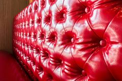 Luxury red leather sofa texture. Close up of luxury red leather sofa texture Royalty Free Stock Photo