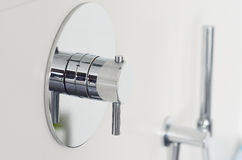 Close up of a luxury shower faucet knob royalty free stock photography