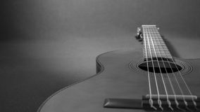 Close-up of a lying acoustic guitar in grayscale. Close-up of a lying acoustic guitar, ideal for use as a grayscale background Stock Photography